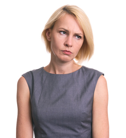 Foto de Portrait of angry woman looking away isolated on white background - Imagen libre de derechos