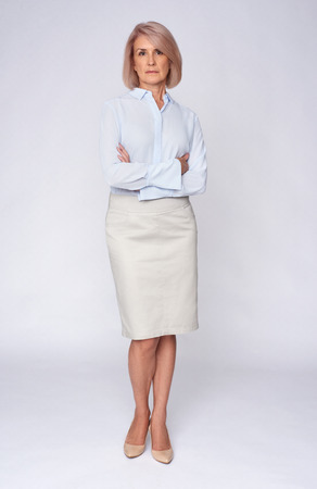 Photo for beautiful senior business woman. Full length portrait. Isolated on grey - Royalty Free Image