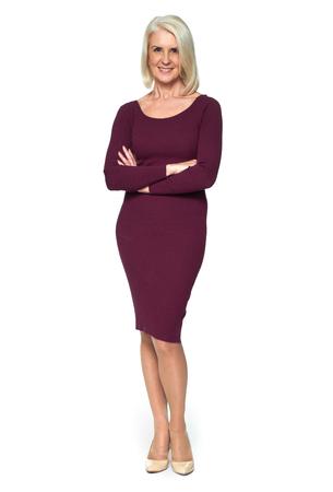 Foto de full length portrait of a beautiful blonde old woman is smiling and standing on white studio background - Imagen libre de derechos