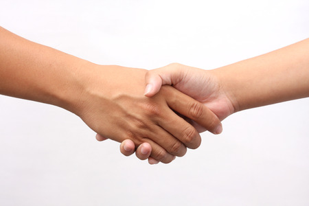 Photo pour Successful man and woman handshaking on white background - image libre de droit