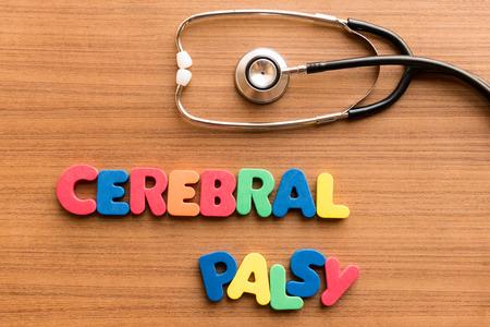 Foto de cerebral palsy colorful word on the wooden background with stethoscope - Imagen libre de derechos
