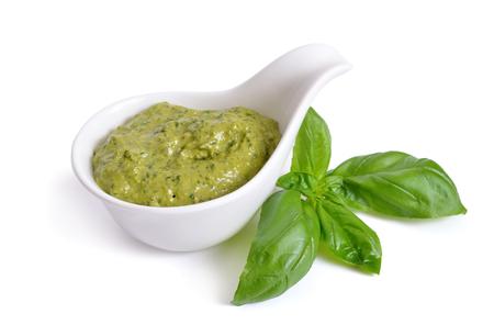 Photo pour Pesto sauce in a bowl. Isolated On white. - image libre de droit