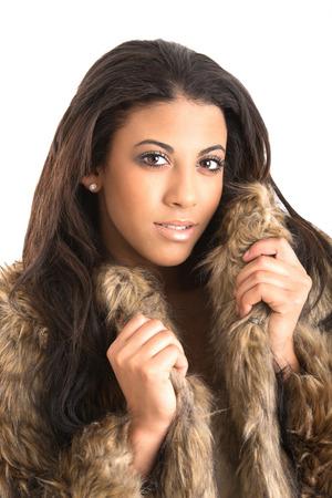 Foto de beautiful young woman fur coat - Imagen libre de derechos
