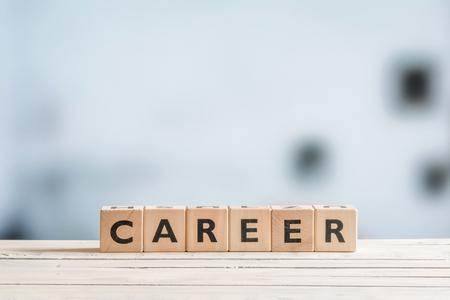 Photo pour Career sign on a wooden desk in an office - image libre de droit