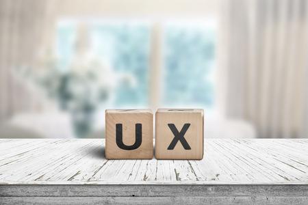 Foto de UX development sign on a table in a bright room with cyan colors - Imagen libre de derechos