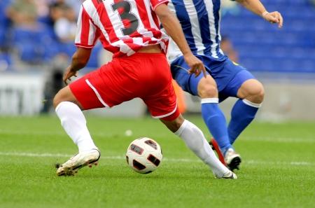 Photo pour Soccer player legs in action - image libre de droit