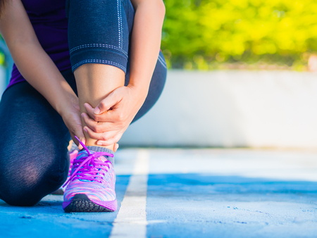 Photo pour Young woman suffering from an ankle injury while exercising and running. Sport  excercise concept. - image libre de droit