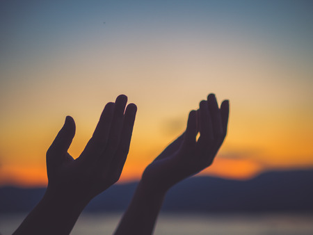 Photo pour Closeup woman hands praying for blessing from god during  sunset background. Hope concept. - image libre de droit