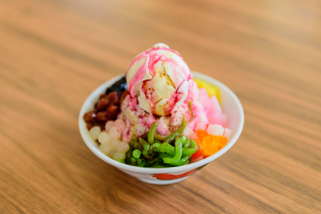 Photo for Soft focus of Ais Kacang topped with basil seeds, peanuts, corn, and a scoop of ice cream. Ice kacang literally meaning - Royalty Free Image