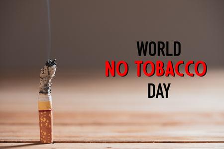 Foto de World No Tobacco Day, May 31. STOP Smoking. Close up burn cigarettes. - Imagen libre de derechos