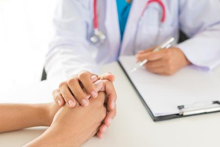 Foto de Doctor holding patient's hand. Medicine and health care concept. Doctor and patient. - Imagen libre de derechos