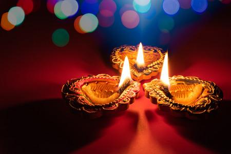 Photo pour Happy Diwali - Clay Diya lamps lit during Dipavali, Hindu festival of lights celebration - image libre de droit