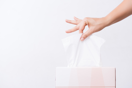Foto de Healthcare concept. Woman hand picking white tissue paper from tissue box. - Imagen libre de derechos