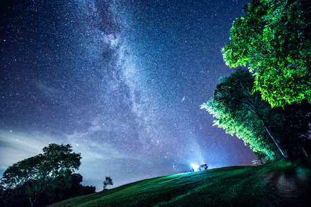 Photo for The Milky Way and some trees. In the mountains of Nan in Thailand - Royalty Free Image