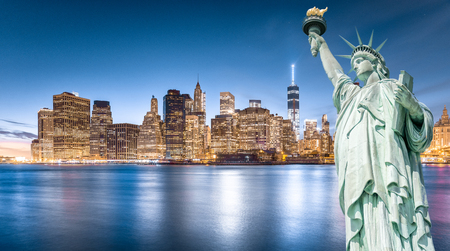 Foto de The Statue of Liberty with Lower Manhattan background in the evening, Landmarks of New York City, USA - Imagen libre de derechos