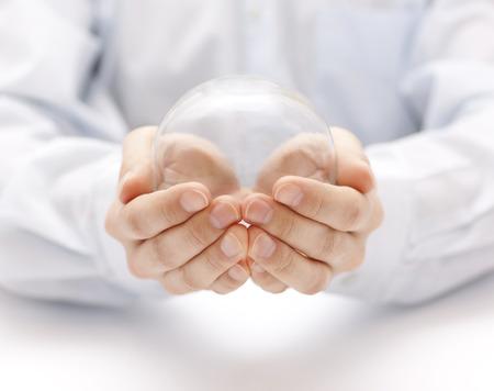 Foto de Crystal ball in hands - Imagen libre de derechos