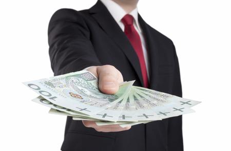 Foto de Businessman holding polish money. Clipping path included. - Imagen libre de derechos
