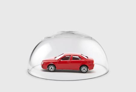 Photo pour Red car protected under a glass dome - image libre de droit