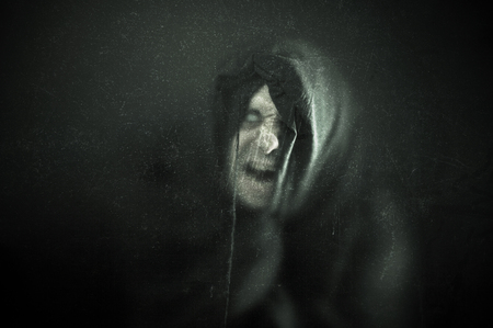 Photo for Angry ghost figure in the dark - Royalty Free Image