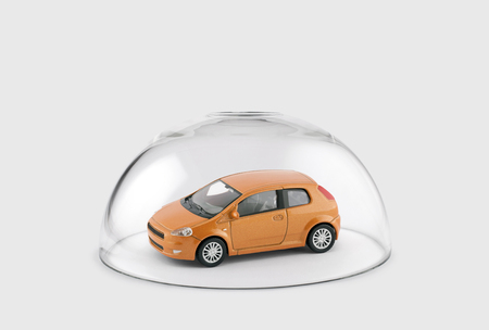Photo for Orange car protected under a glass dome - Royalty Free Image