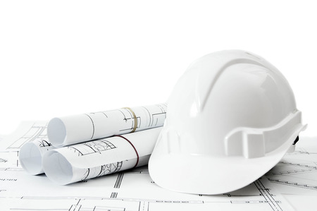 Photo pour Construction house. Repair work. Drawings for building and helmet on white a background. - image libre de droit