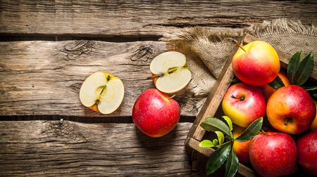 Foto per Fresh red apples in wooden box On wooden background. Top view - Immagine Royalty Free