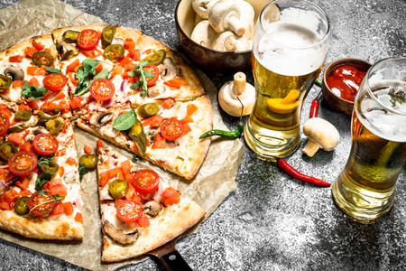 Photo for Mexican pizza with cold beer. On a rustic background. - Royalty Free Image