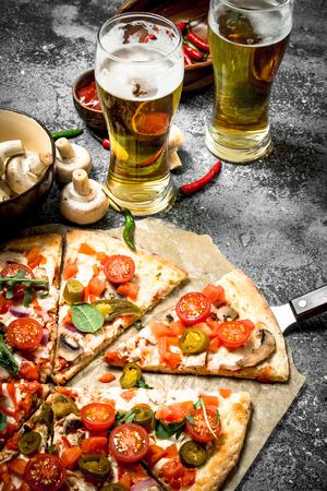 Foto de Mexican pizza with cold beer. On a rustic background. - Imagen libre de derechos