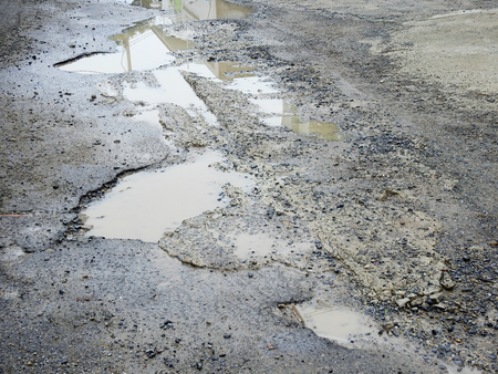 Photo for bumpy broken asphalt road with water flood - Royalty Free Image