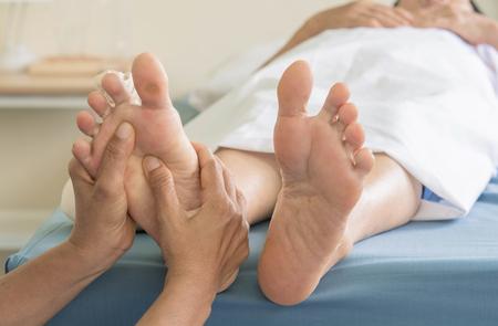 Foto de Foot Massage  old women - Imagen libre de derechos
