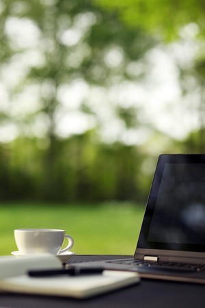 Photo for Laptop and coffee, outdoor office - Royalty Free Image
