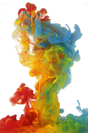 Photo pour Clouds of bright colorful ink mixing in water - image libre de droit