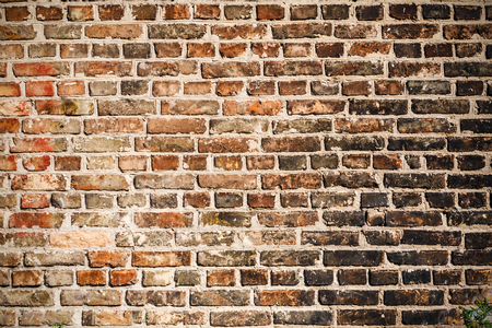 Foto de The texture of a brick wall covered with black soot after a fire. You can use it as a background for your design. - Imagen libre de derechos