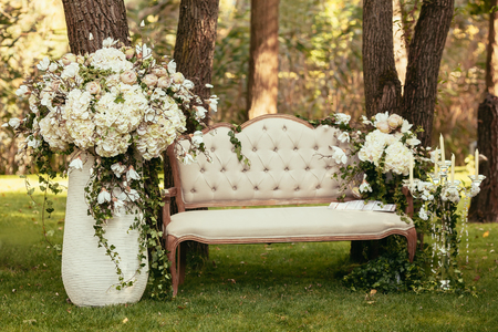 Foto de luxury wedding decorations with bench, candle and flowers compisition on ceremony place - Imagen libre de derechos