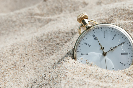 Photo for Pocket watch buried in sand - Royalty Free Image