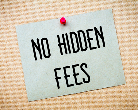 Recycled paper note pinned on cork board. No Hidden Fees Message. Concept Image