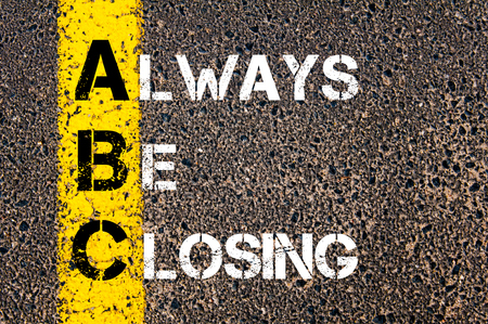 Foto de Business Acronym ABC as Always Be Closing. Yellow paint line on the road against asphalt background. Conceptual image - Imagen libre de derechos