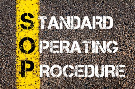 Foto de Business Acronym SOP as Standard Operating Procedure. Yellow paint line on the road against asphalt background. Conceptual image - Imagen libre de derechos