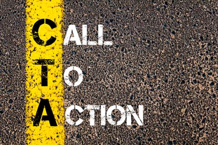 Photo pour Acronym CTA as Call To Action. Yellow paint line on the road against asphalt background. Conceptual image - image libre de droit