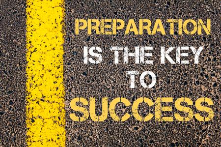 Foto de Preparation is the key to success motivational quote. Yellow paint line on the road against asphalt background - Imagen libre de derechos