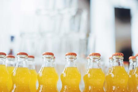 Foto de bottle of Orange Fanta glass soda - Imagen libre de derechos