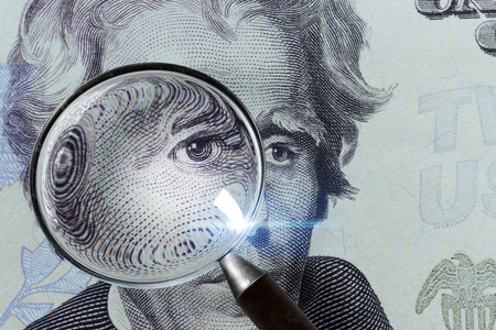 Photo for Dollar banknote under a magnifying glass is being inspected - Royalty Free Image