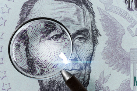 Photo for US President Abraham Lincoln face on the five dollar bill macro, 5 USD, US money close up under magnifying glass - Royalty Free Image