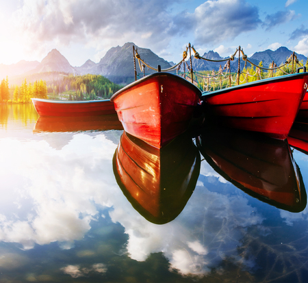 Foto per Boat on the dock surrounded mountains. Fantastic Shtrbske Pleso High Tatras. Slovakia - Immagine Royalty Free