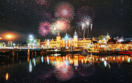 Photo for Beautiful calm night view of Amsterdam city. Colorful fireworks on the black sky background. Photo greeting card. Bokeh light effect, soft filter. - Royalty Free Image