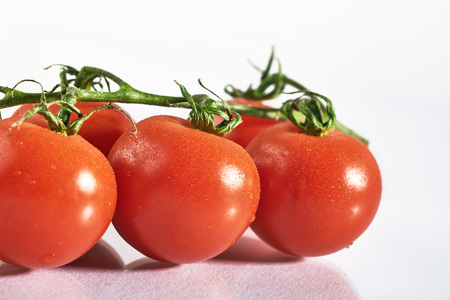 Photo for Branch of red organic tomatoes on a white background - Royalty Free Image