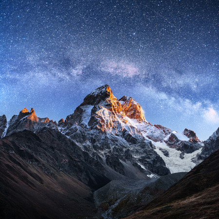 Photo pour Fantastic starry sky. Autumn landscape and snow-capped peaks. Main Caucasian Ridge. Mountain View from Mount Ushba Meyer, Georgia. Europe - image libre de droit