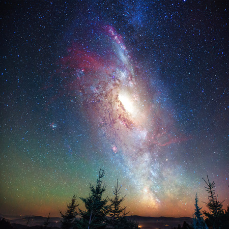 Photo pour Fantastic starry sky and the milky way above the pinnacles of the pines. Courtesy of NASA - image libre de droit