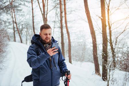 Photo pour Man Traveler with backpack hiking Travel Lifestyle adventure concept active vacations outdoor. Beautiful landscape  forest - image libre de droit