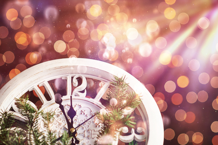 Photo pour Happy New Year at midnight 2018, Old wooden clock with holiday lights and fir branches. Bokeh light soft effect. - image libre de droit